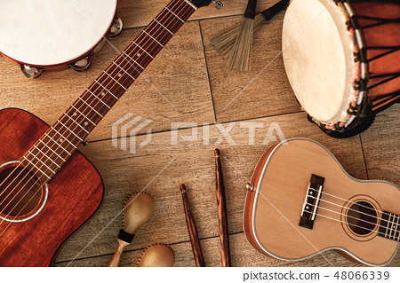 Ethnic musical instruments set: tambourine, wooden drum, brushes, wooden sticks, maracas and guitars 48066339