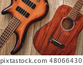 What to choose Top view on two cool musical instruments: acoustic and electric guitars are lying on 48066430