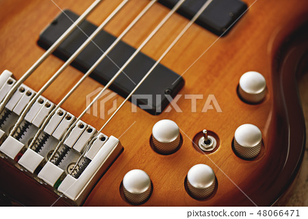 Parts of Electric guitar. Close up view of electric guitar body with volume and tone control knobs 48066471