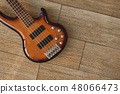 Electric Guitar Sounds. Top view of the electric guitar body against of the wooden floor. Music 48066473