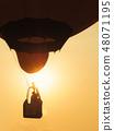 Silhouette people in balloon basket on sky 48071195