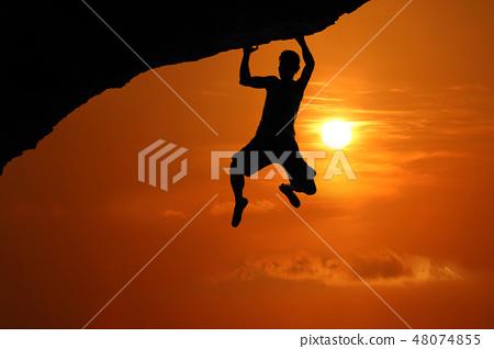 Silhouette of asian man climbing rock 48074855