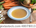 Chicken bone broth in a plate with vegetables 48078013