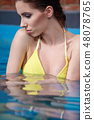 Woman in water pool 48078765