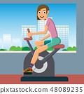 engaged in training on a stationary bike. 48089235