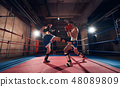 Boxers training kickboxing in the ring at the health club 48089809