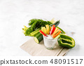 Colorful slices of raw vegetables in glass 48091517