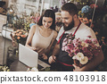 Young girl chooses bouquet option on laptop 48103918
