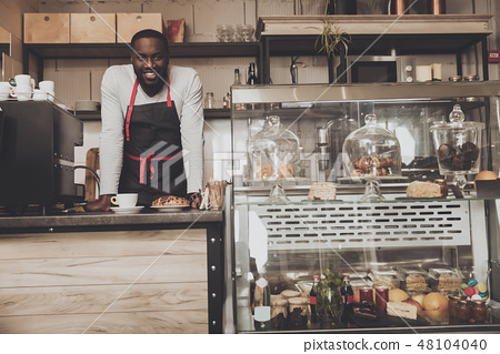 Smiling afro american barista male at work 48104040