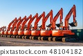 A complect of new excavators sold and parked 48104182