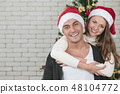 Caucasian man and beautiful woman standing an 48104772