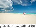 red parasol on the Caribbean beach 48104994