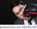 Asian business man in suit hurt himself. 48106160