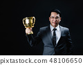 Asian man in formal suit and trophy. 48106650