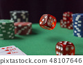 Red dice, casino chips, cards on green felt 48107646