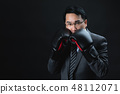 Asian man in formal suit and boxing gloves 48112071
