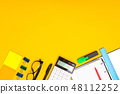 stationery at the bottom of the image is isolated on a yellow background 48112252