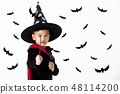 Young kid in witch costume dress 48114200