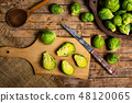 Brussels sprout vegetables on a cutting board 48120065