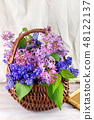 Lilac flowers in a wicker basket 48122137