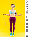 Blonde-haired woman skipping the rope while losing weight 48126877