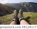 Hiking boots on a mountain tour 48128117