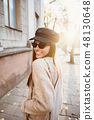Street portrait of young beautiful fashionable woman 48130648