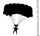 Skydiver flying with parachute 48130743