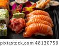 Mix sushi set, on black stone background. 48130759