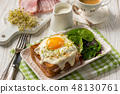 Croque madame, hot french toasts with ham . 48130761