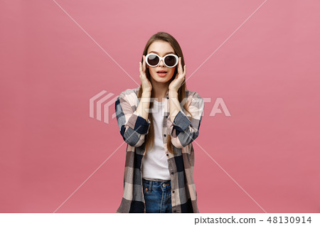Photo closeup of charming womanwith long hairstyle wearing trendy sunglasses looking at camera with 48130914