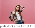 Young caucasian woman over isolated background smiling looking to the camera showing fingers doing 48131113