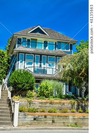 Residential house built up on land terrace in Vancouver, British Columbia. 48135663