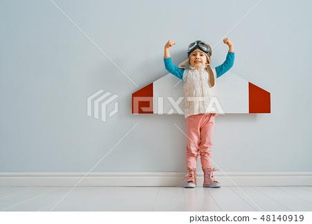 girl in an astronaut costume 48140919
