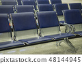 Airport terminal, empty waiting chairs near gate 48144945