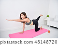 Concept of exercise. Beautiful girl is exercising in her house. 48148720