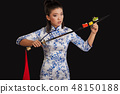 Young asian beauty is holding sushi on katana 48150188