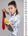 Young asian woman is holding sushi on sword 48150585