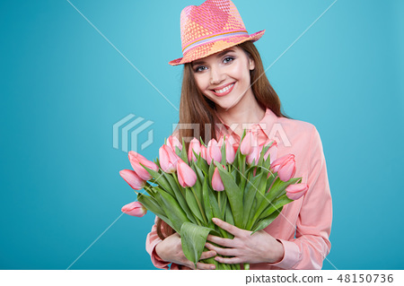 Young beautiful woman studio portrait with tulip flowers 48150736