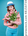 Young beautiful woman studio portrait with tulip flowers 48150739
