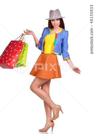 Casual style woman hold shopping bag. Studio female isolated por 48150833