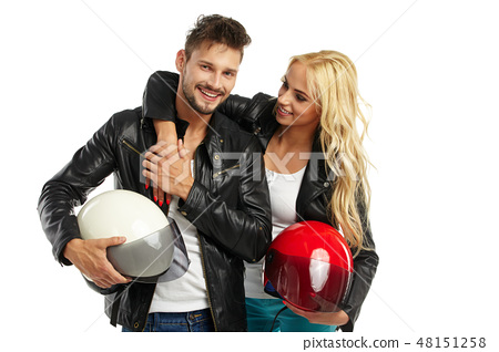 motorcyclists couple with helmets in hand 48151258