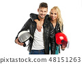 motorcyclists couple with helmets in hand 48151263
