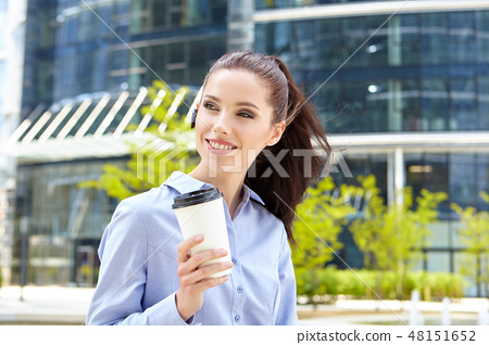 Happy young student with a coffee-to-go 48151652