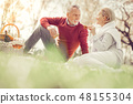 Handsome mature man sitting opposite his wife 48155304