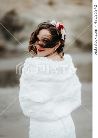 Beautiful bride on the seacoast. Flowers in hair 48155542