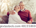 Dreamy mature female leaning on her man 48155869