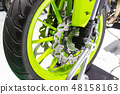 Motorcycle wheel in black and green  48158163