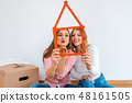 Two women having rented a new apartment moving in  48161505