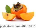 Persimmon fruit with slice and leaf isolated 48162015